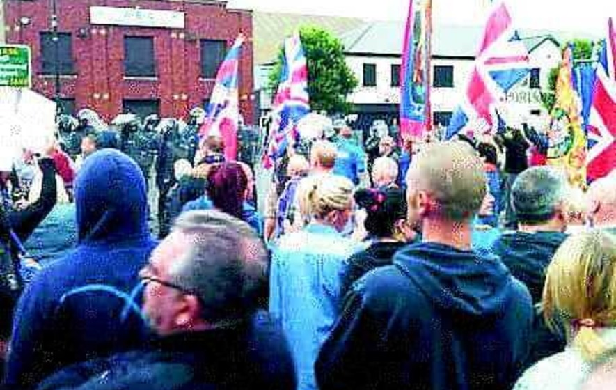 Illegal loyalist parade breaks through line of riot police
