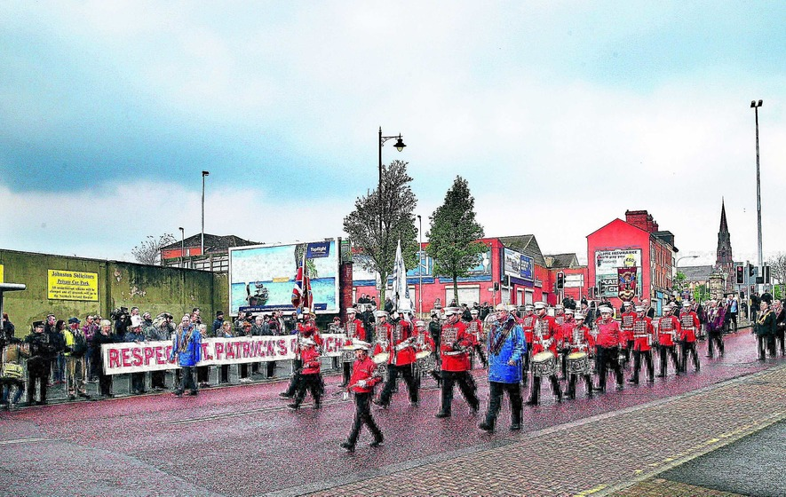Controversial parade passes church with single drum beat