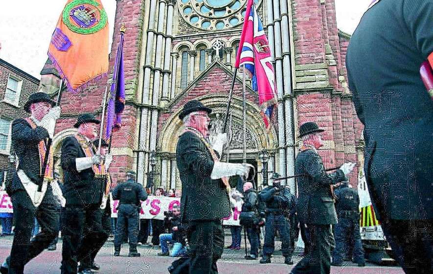 Bands ordered to play hymns passing church