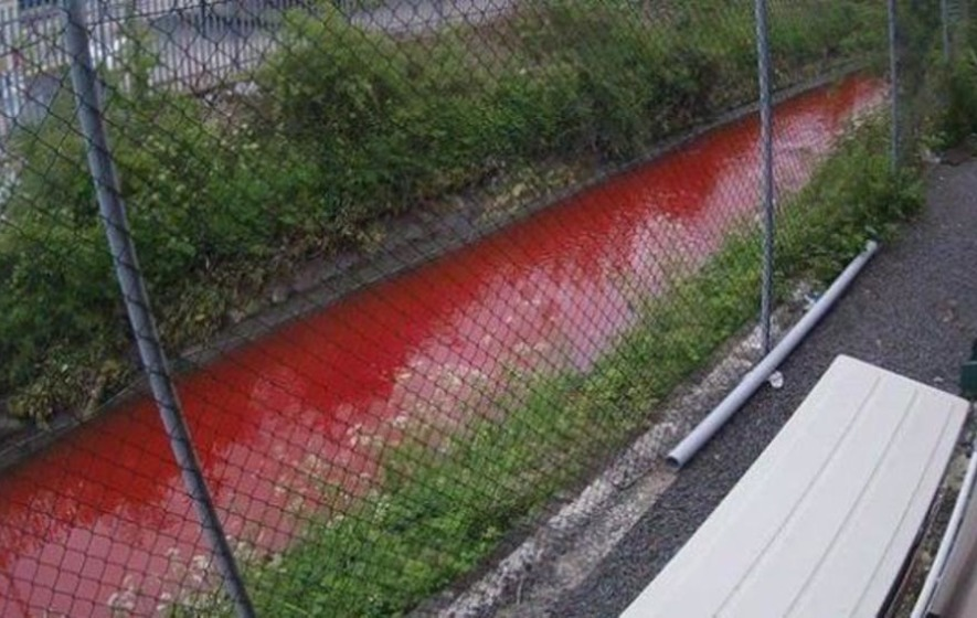 Pollution spill turns west Belfast river red