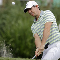 Woods keeps the pressure on McIlroy at Sawgrass
