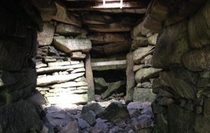 Volunteers carry out repairs on Slieve Gullion tomb