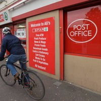 Baby held as father forced to rob Post Office