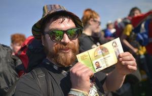 Music fans pour through the gates at Glastonbury festival