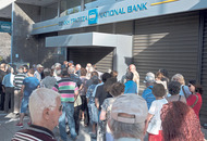 Pensioners swarm banks after Greece restricts capital