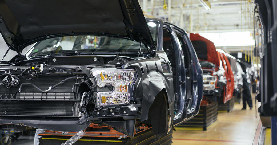Detroit motor city gets its mojo back after years of for Motor city assembly line