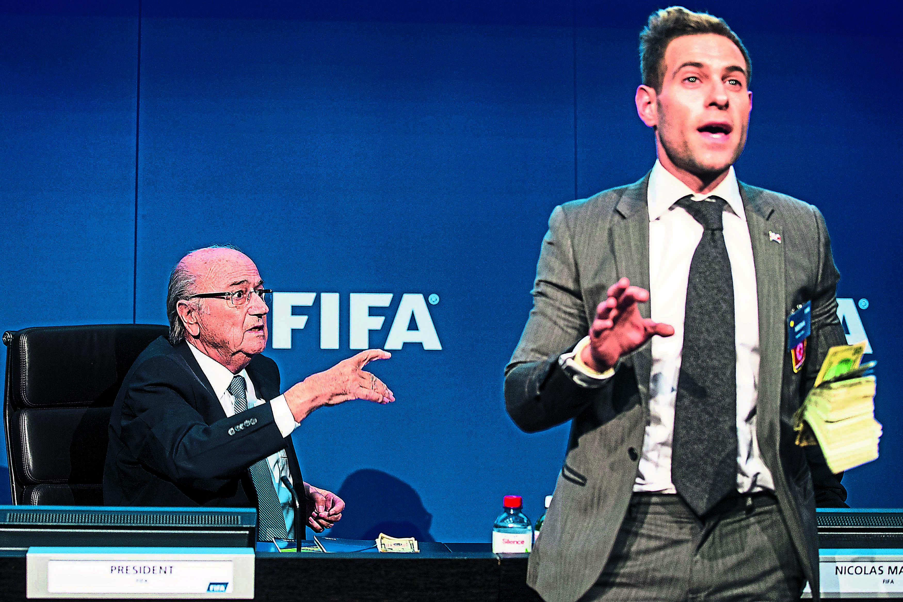 Prankster showers Fifa chief Blatter with cash