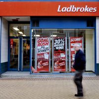 Bookmakers Ladbrokes and Coral agree £2.3 billion merger