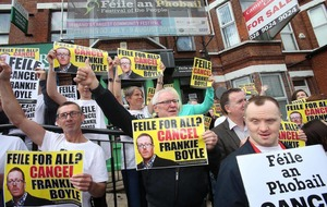 Protestors converge on Falls to oppose Boyle show