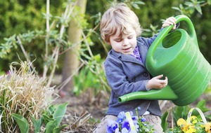 Enjoy the great outdoors with kids taking in the wonders of the garden