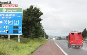 Motorway signage advertising appears on M2
