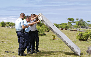 MH370 investigators examine washed-up wing