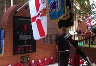 Housing Executive rejects calls to remove UDA parade memorial