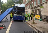 NEW  :  Bride taken to hospital after London bus crashes into tree