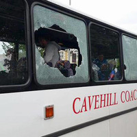Attack on bus returning from parade 'shameful', says priest