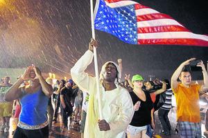 Anniversary of Ferguson killing sparks days of renewed violence