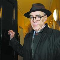 Poet questions Irish language skills of Adams