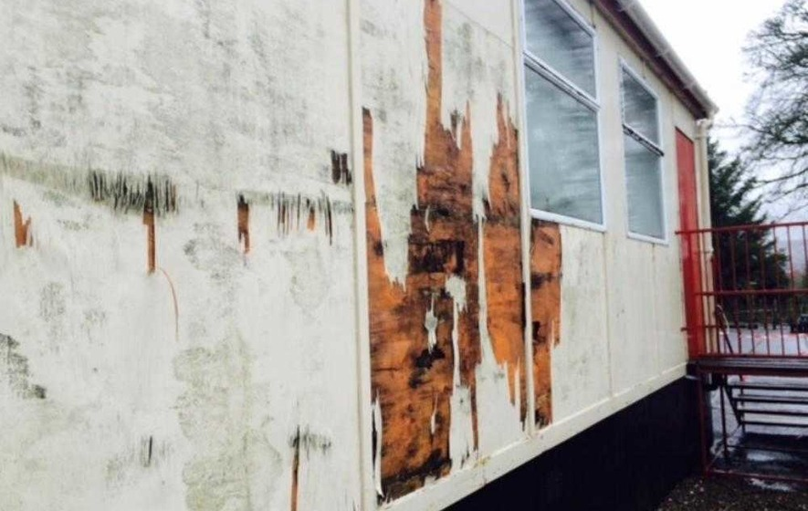 Pupils forced to use mobile classroom 'covered in damp'