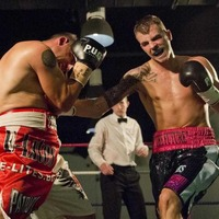 Hyland made to work for lightweight title win