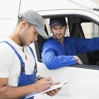 White van man packs up his tools as building work stalls
