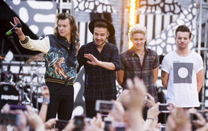 One Direction fans left crying in the rain after show called off
