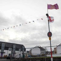 "Loyalist flags now on ""every lamppost"" at new development"