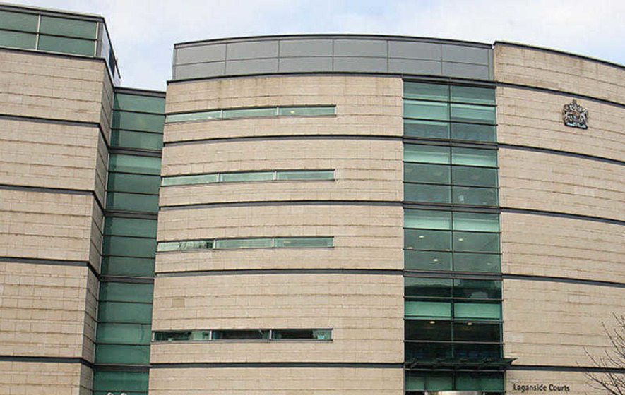 Woman accused of defrauding west Belfast groups of £130,000