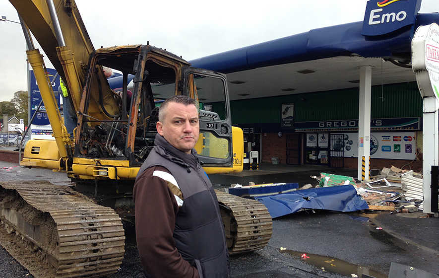 Video: Thieves use digger to rip ATM from wall