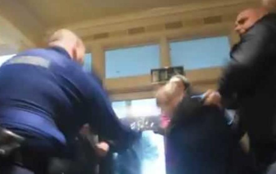 Garda strikes elderly man at Nama auction protest