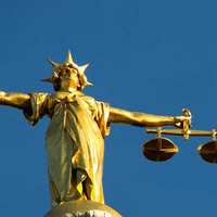 Man claimed he was pinned against railings by car, court hears