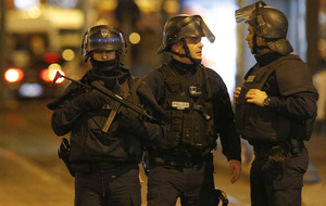 Paris attacks: two suspects killed in dawn raid