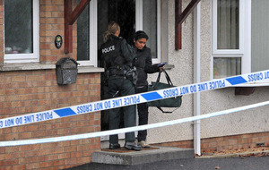 Early morning arson attack on family `race hate crime'
