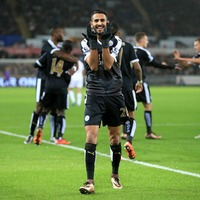 Riyad Mahrez hat-trick sends Leicester top at Swansea