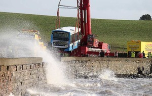 Bus lifted off lough shoreline after crashing through a wall