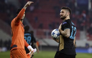 Giroud targets last eight as Arsenal reach knockout stages