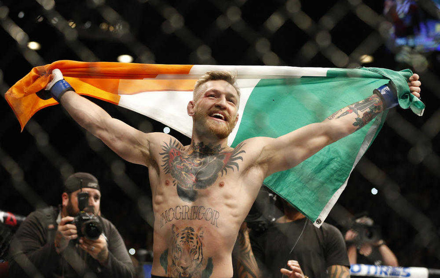 New champ Conor McGregor celebrates Vegas win with fans